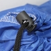 Closeup of a Black Toggle Slip Lock Closure on a Blue Polyester Laundry Bag